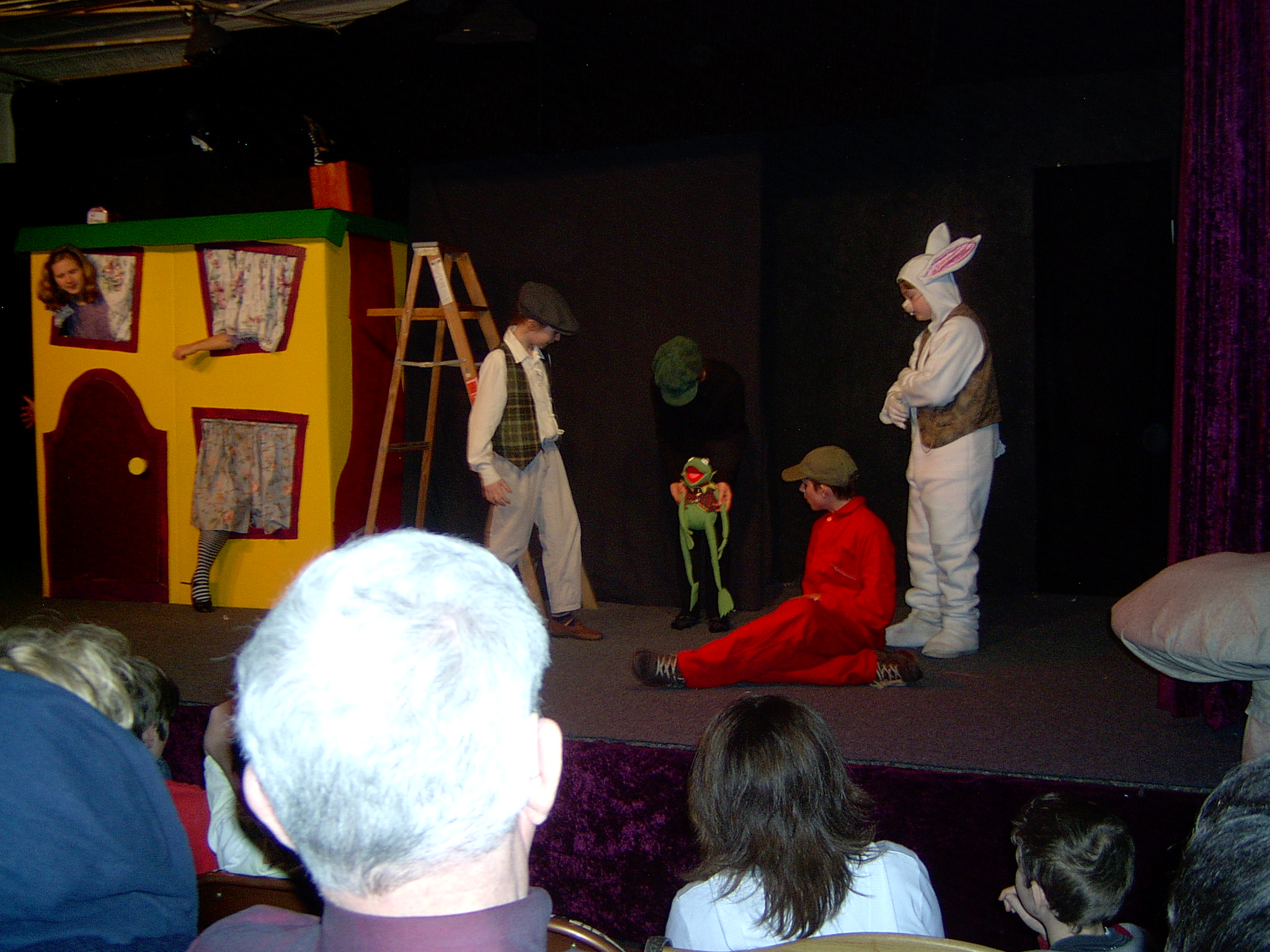Alice Grows Until Her Head Arms And Legs Stick Out The Chimney Windows Of White Rabbit S House In This Photo From Firehouse Theater Fort